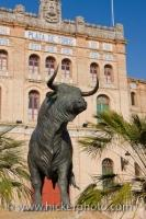 A bull statue stands guard outside the world famous and oldest operational Plaza de Toros, aka bullfighting arena, in El Puerto de Santa Maria in the province of Cadiz in Andalusia, Spain.