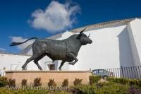 A large bull statue adorns the entranceway to the Plaza de Toros in the town of Ronda in the Province of Malaga in Andalusia, Spain.