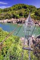 A popular tourist attraction in the Buller Gorge, the Buller River Swingbridge is a part of an Adventure and heritage park in the South Island of New Zealand.