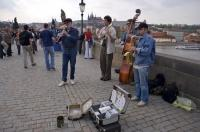 Buskers get a suitcase full of change as the play for the people that cross the Charles Bridge in Prague in the Czech Republic.