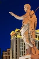 Life size Augustus Caesar statue illuminated at the entrance of the Caesar Palace Hotel and Casino, photographed at dusk, Las Vegas, Nevada.