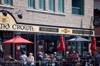 Patrons at a cafe at the Byward Market in Ottawa, Ontario enjoy a beverage on the outside deck under the beautiful clear summer sky.