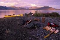 Kluane Lake in the Yukon of Canada is a great place to camp out for the night and sit around the camp fire with friends during a summer vacation.