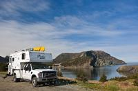 A camper is a great way to travel to see all the highlights of Newfoundland. Such highlights include places like Bottle Cove a small indent along Newfoundland's coastline in the Gulf of St Lawrence.