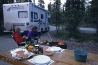 A couple enjoy an evening camping with their Motor Home in a campground in the Yukon Territory of Canada.