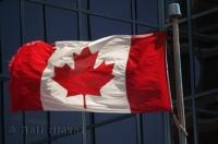 The Canadian flag features a red maple leaf as well as red and white stripes.