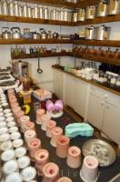 Moulds, wax, and cookers make up some of the equipment needed for making hand crafted candles.