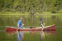 A couple paddling away on a canoe tour in Northern Newfoundland near Main Brook