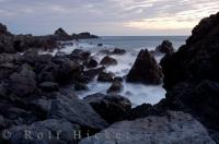 Ocean waves crash against the rugged coastline as the tide makes it way in at Cape Palliser in Southern Wairarapa on the North Island of New Zealand.