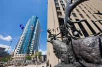 The front of the bronze sculpture of caribous crossing a river, which is actually called 'Seal River Crossing' stands proudly outside the Richardson Building, near the Canwest Place Building in downtown Winnipeg in Manitoba, Canada.