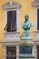 A Bust of Carlo Angeloni, a talented musician and native son of Lucca is back-dropped by a Tuscan Villa in a square in the city of Lucca which is in the beautiful Tuscany region of Italy.