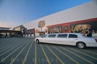 An extended limousine with a chauffeur waits outside the Indian Casino in Orillia, Ontario in front of the beautifully decorated walls.