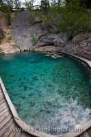 A steaming hot spring which is home to the endangered Banff Springs Snail at the Cave and Basin National Historic Site in the town of Banff, Alberta, Canada.