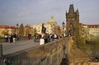 Vendors sell their wares to passing pedestrians on the historic and recognizable Charles Bridge, which dates back to 1357. It was originally called the 'Stone Bridge' and is visited by thousands of tourists to Prague every year.