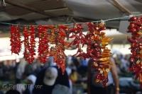 Chili peppers hang from a line in Chinatown in Toronto, Ontario in Canada.