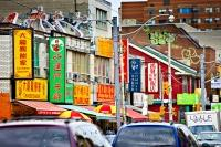 Colorful street signs written in Chinese adorn the streets of Chinatown in the City of Toronto, Ontario in Canada.