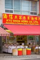 A bright red sign above the awning at a Chinese store in Chinatown in Toronto, Ontario which specializes in health foods.