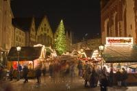 An action packed photo of the annual christmas markets at night in the Roemerberg (City Hall Square) in the city of Frankfurt, Germany.