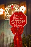 With Christmas lights blazing in the background ... a funny stop sign is posted in front for Santa to see. It reads: Santa Please STOP Here.