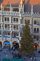 An aerial photo of a large, decorated christmas tree in the Marienplatz next to the Neues Rathaus in the city of Muenchen, Bavaria, Germany.