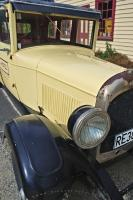 The old vintage chrysler car fits into the scene parked outside the Cardrona Hotel in Central Otago.