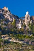 A winding road up the mountainside takes you to the ruins of the Castle of Guadalest and the church belfry in the town of Guadalest in Comunidad Valenciana, Spain.
