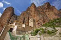 As the bells of the church in the village of Riglos in Aragon, Spain chime they send echoing sound effects off the rock formations of the Mallos de Riglos.