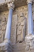 The ornate Eglise St Trophime pillars on the exterior of the church in the city of Arles, Provence in France, Europe.