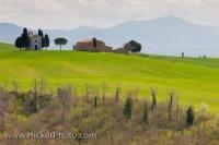A small church sits on the hillside on the sunny Tuscan landscape en route to the town of Pienza in the Province of Siena in Italy, Europe.