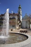 The water in the circular fountain glistens in the sun in the town square of Toblach in the South Tyrol of Italy.