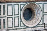 One of the eight circular windows under the dome of the Florence Duomo in the city of Florence in the Region of Tuscany in Italy, Europe.