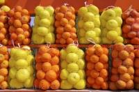This citrus market stall near Oliva Nova in Valencia, Spain shows the delicious beauty of the local fruit for sale.