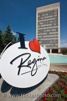 A view behind an 'I Love Regina' sign of the City Hall Building and fountain, located in Queen Elizabeth II Court in Regina, the province of Saskatchewan, Canada. Opened in 1976, it became the new City Hall after the old one was demolished.