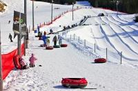 A fun and adventurous winter activity which is suitable for the whole family, the Coca Cola Tube Park on Blackcomb Mountain is easily accessed from Whistler Village in British Columbia, Canada.