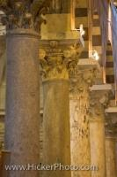 Ornate and decorative columns adorn the interior of the Duomo cathedral in Pisa, which is a city and province in Tuscany. This is a UNESCO World Heritage Site that is visited by thousands of tourists every year.