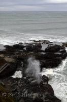 The pounding Pacific Ocean surges and forces water through the blow hole at Cooks Chasm in Oregon.
