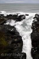 The mighty Pacific Ocean shows its power as it relentlessly pounds the coastline at Cooks Chasm in Oregon.