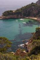 Peaceful bays are found around different points and rock ledges along the Costa Brava coastline in Catalonia, Spain in Europe.