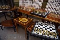 Crafted chess sets for sale at a market stall near the famous Ponte di Rialto in Venice, Italy.