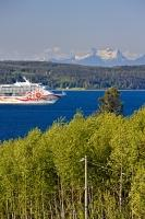 A large cruise ship sails through Broughton Strait, between Malcolm Island and Vancouver Island in British Columbia, Canada.