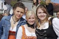 These cute girls are residents of Bavaria enjoying the Maibaumfest in Putzbrunn, Germany.