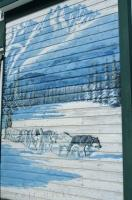 A beautiful wall mural displayed on a door at the Klondike Gold Rush site in Dawson City in the Yukon Territories tells a tale of days past.