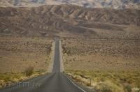 The good conditions of the main desert road which runs through Death Valley, California help with the long hot drive.