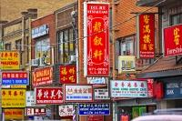 Hundreds of decorative signs displayed on the buildings in Chinatown in the City of Toronto, Ontario in Canada.
