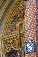 This decorative mural is found on the facade above the entrance to Martinskirche or St Martin's Church as it is known in English.