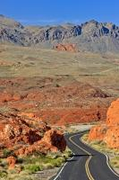 From the winding road, across the desert floor to the hills in the background, a medley of colours paint the landscape in the Valley of Fire State Park of Nevada, USA.