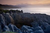 Blowholes, sunsets, intriguing rock formations, and West Coast vistas make the Pancake Rocks a prime travel destination in Paparoa National Park of New Zealand.