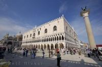 The impressive Doges Palace and one of the two columns of San Marco and San Teodoro in the Piazzetta San Marco in Venice, Veneto in Italy, Europe.