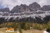 Snow still partly covers the Dolomite Range in the spring near the town of Tires in South Tyrol, Italy, Europe.