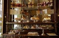 Exquisite pastries and chocolate delicacies line the shelves in the Demel that is situated in the downtown core of Vienna, Austria.